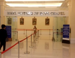 The entrance to Mary Mother of Hope Chapel. The chapel occupies an entire floor and this is what you will see after you step out the escalator. There are barriers to guide the attendees.
